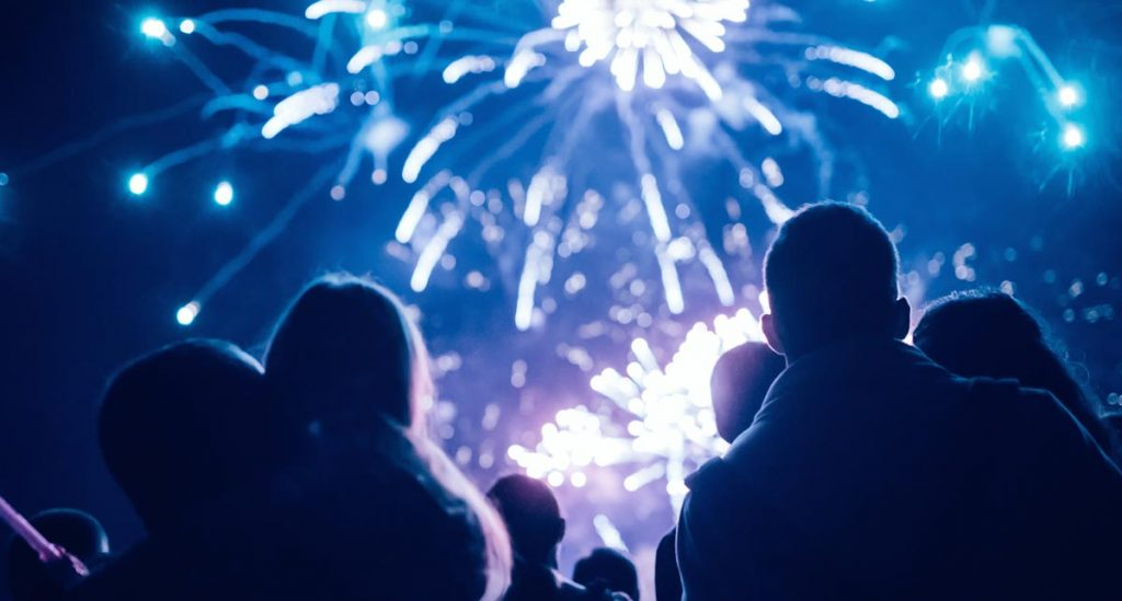 Silhouette of Fathers Holding their Children Watching Fireworks